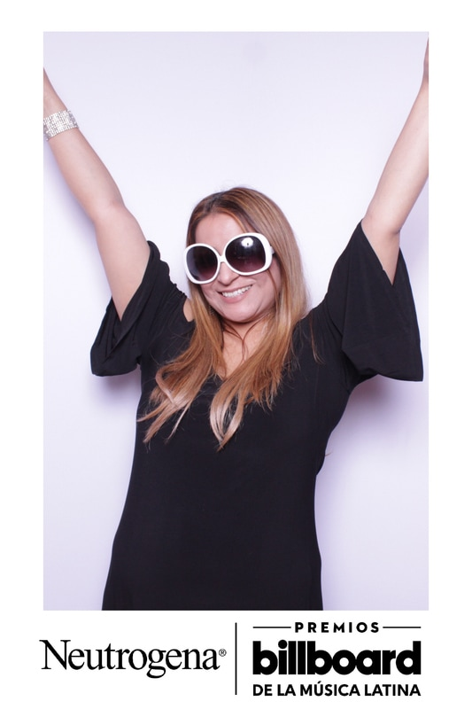 Enjoying the photo booth at a trade show social event in Miami, FL