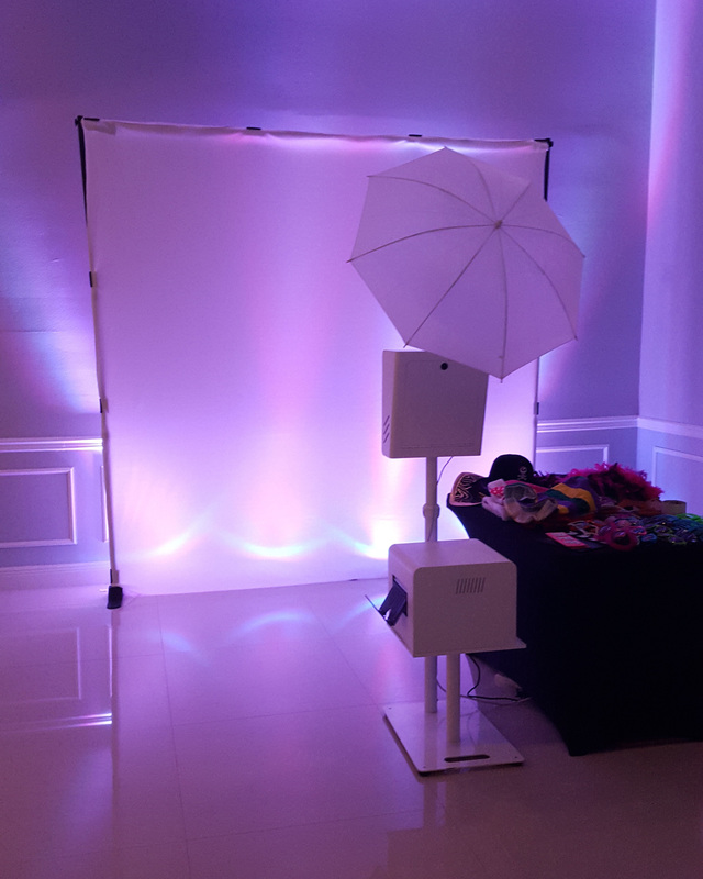 White Photo Booth with uplights in Aventura, FL